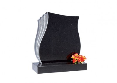 Star Galaxy granite headstone with hand carved rebate on the left edge.