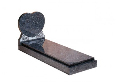 Blue Pearl granite kerb set with engraved rose ornament and cover slab.