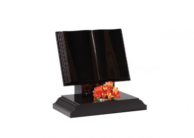 Black granite book memorials with stepped and polished page edges.
