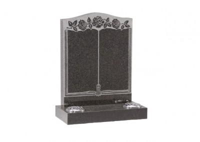 Dark grey granite headstone with embossed floral book design.