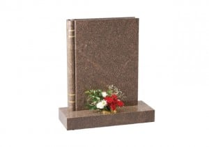 Yellow Teak granite memorial with a fully worked representation of a 'book of life'.