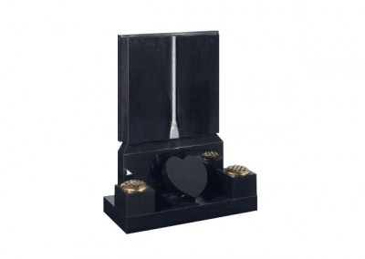Black granite headstone with carved cord and tassel engraving and heart token.