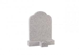 Cornish granite headstone with separate vase in front.