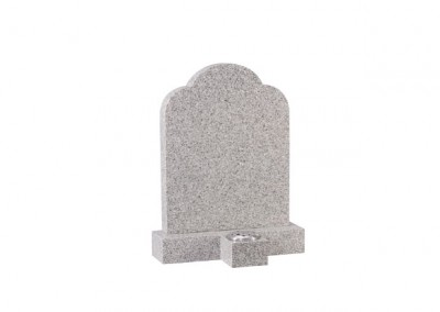 Cornish granite headstone with separate vase in front.