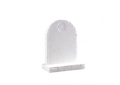Nabresina Stone headstone with pitched edges and carved rose design.