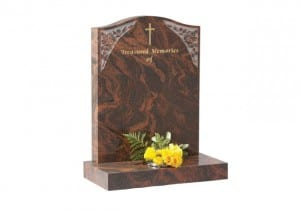 Memorial headstone with etched design and single flower container