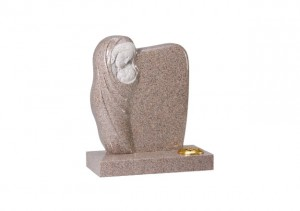 Carnation granite headstone with hand carved 'Madonna and Child' ornament.