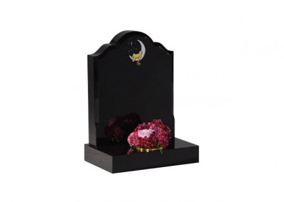 Black granite headstone with hand painted 'baby in moon' design with moulded edge.