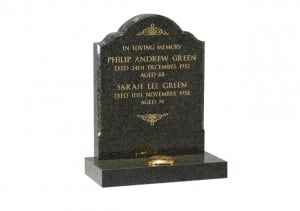 Fir Green granite gravestone with chamfered sides and gilded inscription.