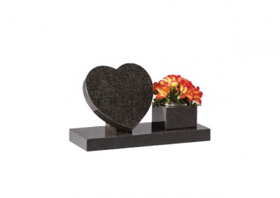 Dark Grey granite heart memorial on riser with side vase.