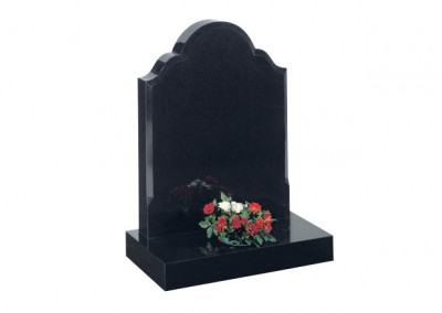 Black granite headstone with chamfered sides.
