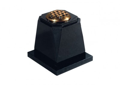 Black granite flower vase with corner chamfered and check cut around the top.