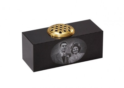 Black granite memorial flower container with a photographic etched portrait.