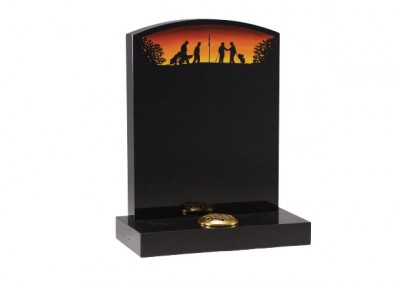Black granite headstone with etched and painted design.
