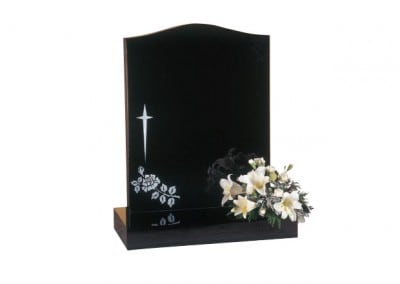Black granite headstone with star cross and rose design.