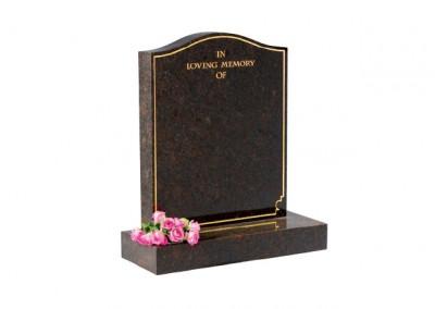 Ruby Red granite memorial with plain pin line.