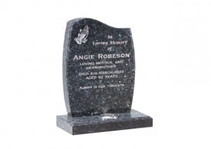 Grey curved headstone with single flower container
