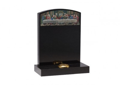 Black granite headstone with etched and painted 'Last supper' design.