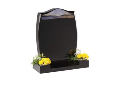 Black granite memorial with chamfered headstone and centre splay base.