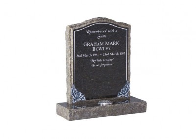 Blue Pearl granite memorial with hand carved roses and pitched edges.