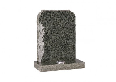 Ocean Green granite headstone with carved daffodil design and pitched sides.