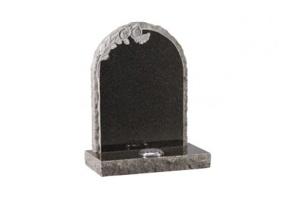 Dark Grey granite memorial with carved roses and pitched edges.