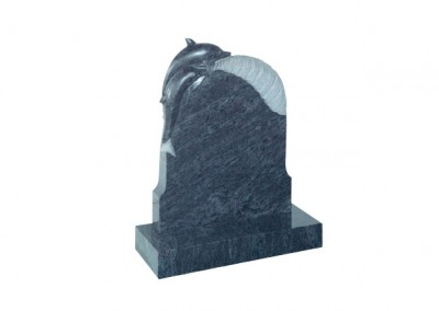 Bahama Blue granite headstone with carved dolphin on a wave.