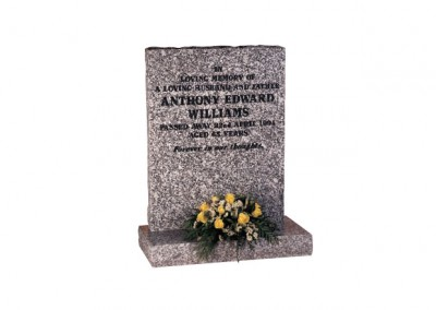 Mervyn Grey granite memorial with natural pitched edges and black painted inscription.