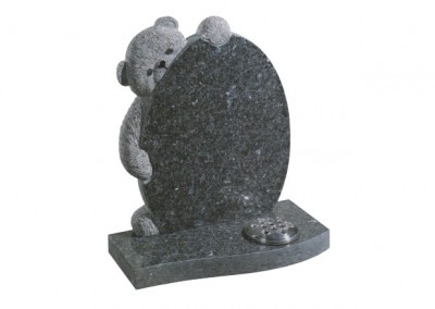 Blue pearl granite headstone with hand carved teddy bear.