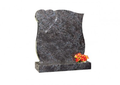 Bahama Blue granite headstone with curved sides and polished heart in top corner.