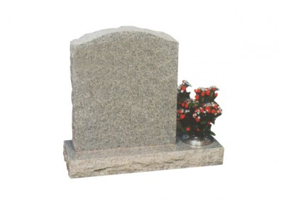 Light Grey granite headstone with pitched side and off-set flower container.