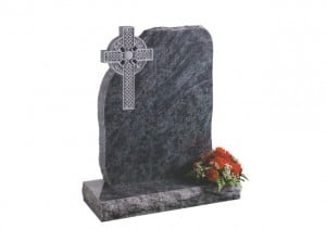 Bahama Blue granite headstone with a rustic shape and deep carved Celtic cross.