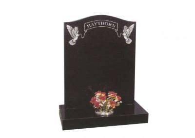 Black granite headstone with fine etched dove & ribbon design.