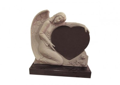 Black granite headstone with carved angel cradling a heart.