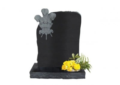 Black granite headstone with deep carved Welsh 'three feathers.'