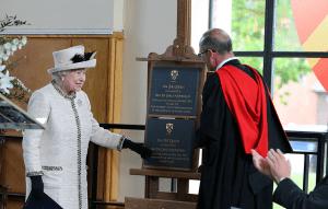 Queen Elizabeth II with commemorative plaque