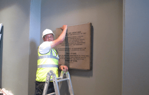 Imperial War Museum Plaque Being Fitted