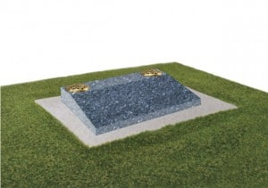 Blue pearl granite desk with two flower containers and concrete base.