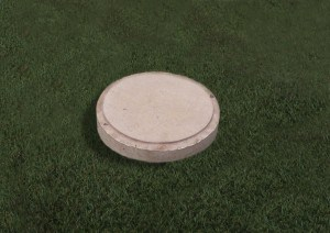 Round natural Limestone plaque with a pitched edge.